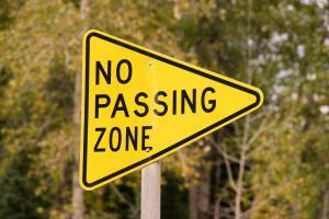 no passing zone sign