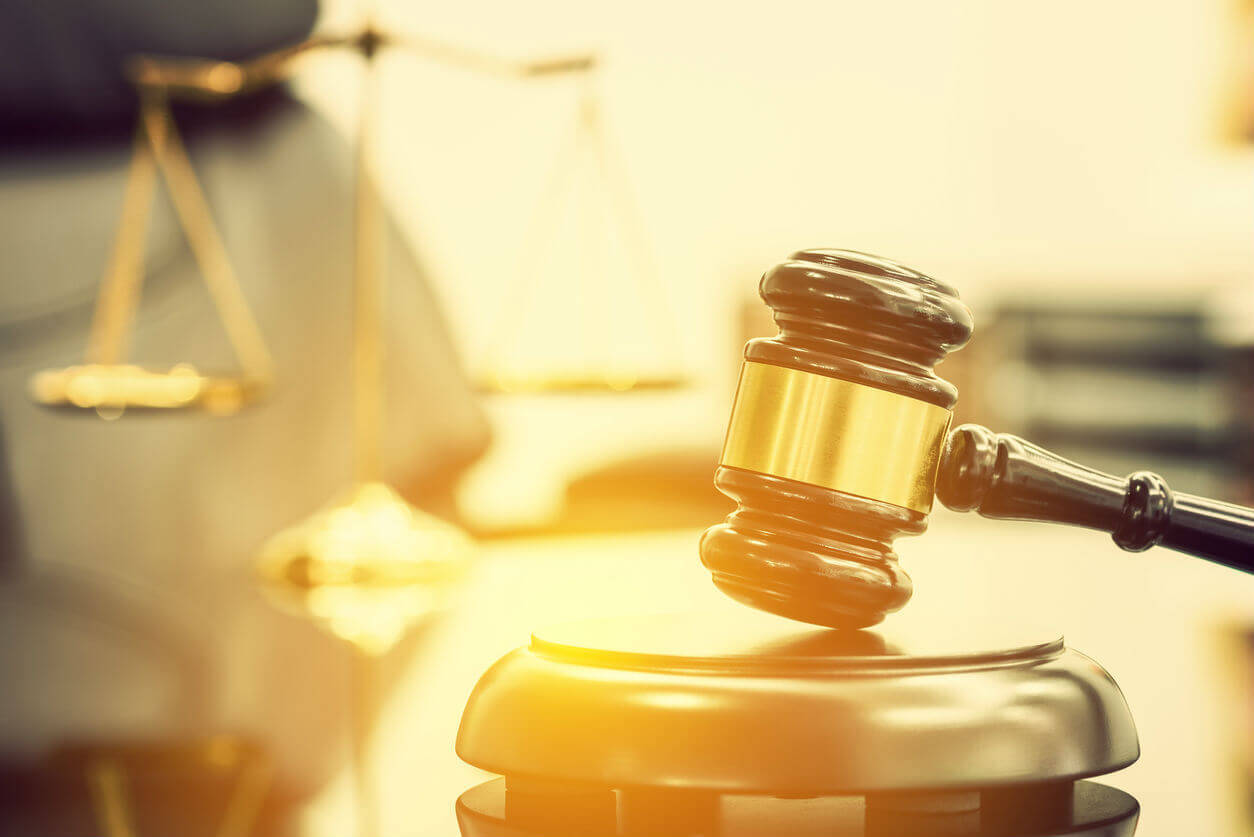 gavel next to scales of justice
