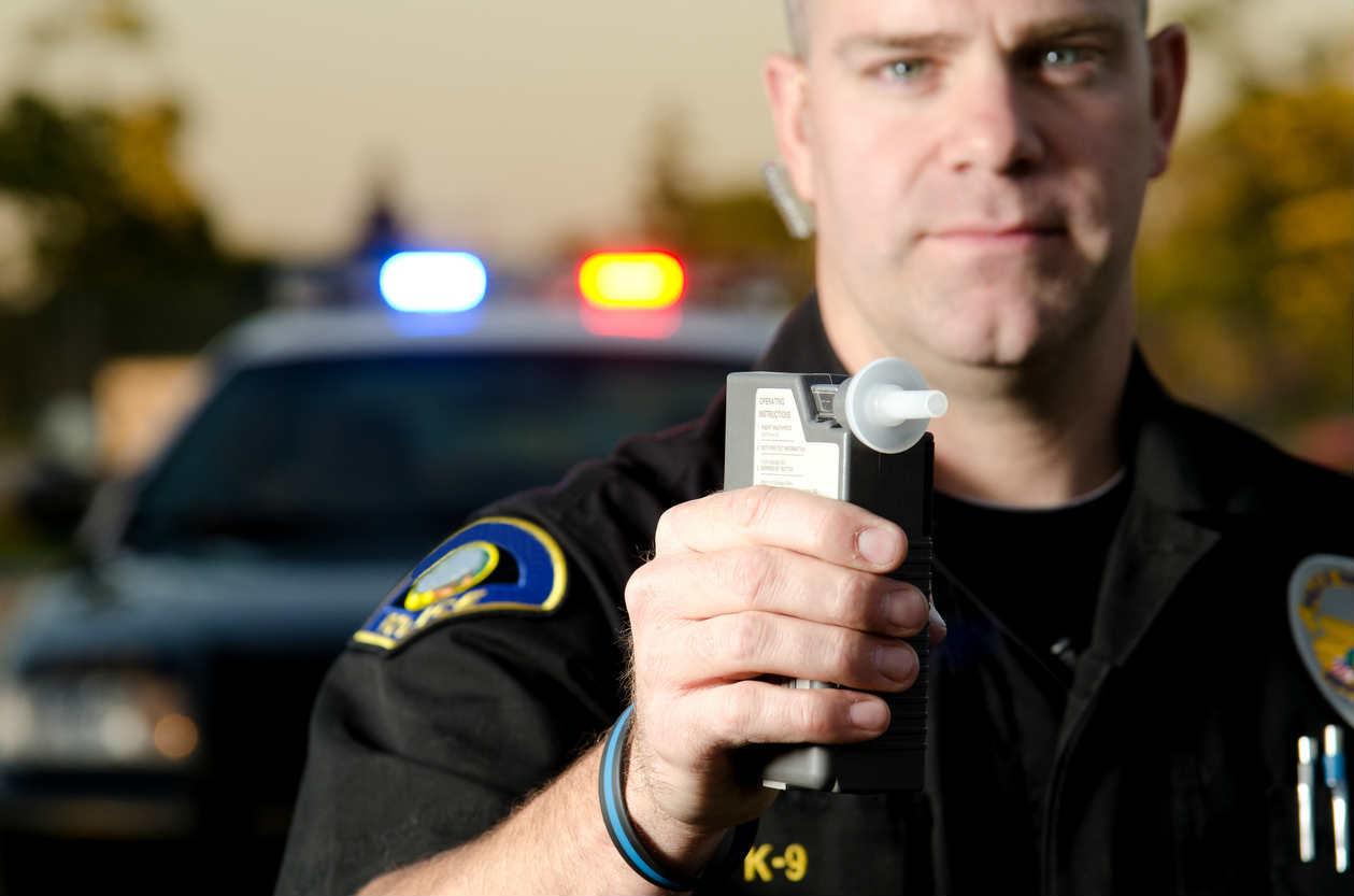 police holding breathalyzer