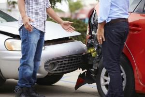 Two men talking after a car accident