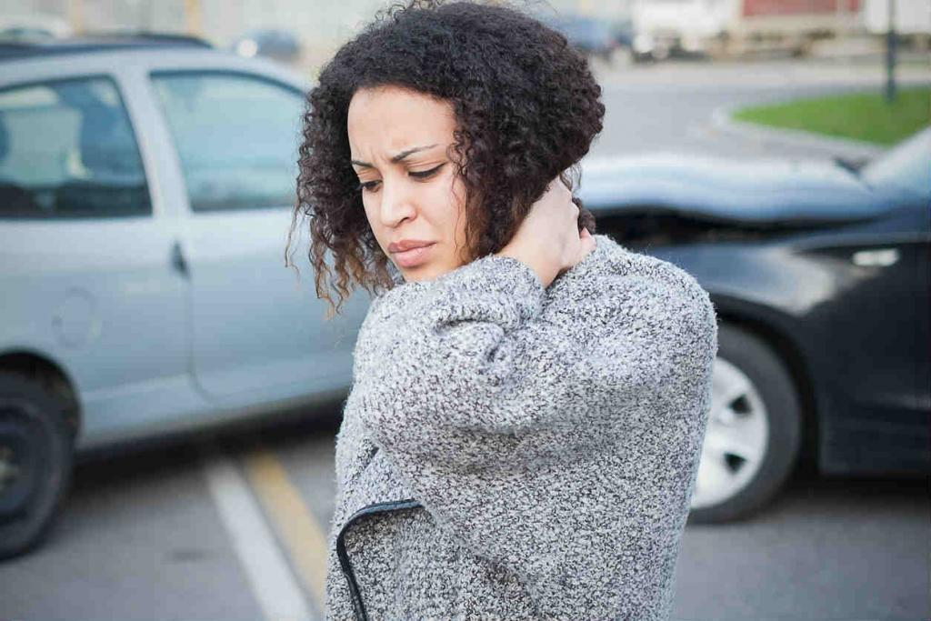 woman holding her neck after a car accident