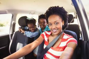 mother driving with children