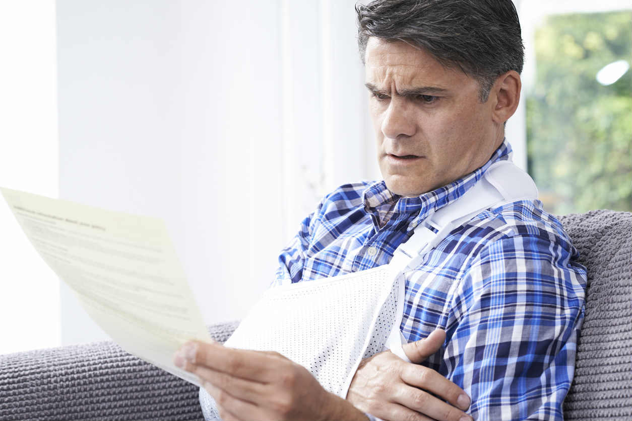 injured man reading letter