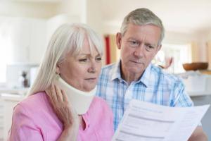 injury victim looking at medical bills