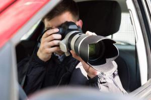 private investigator taking pictures after car accident