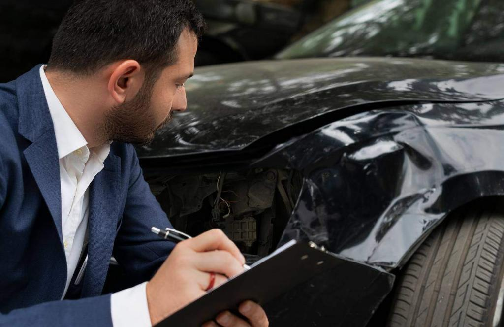 insurance adjuster examining car accident damage