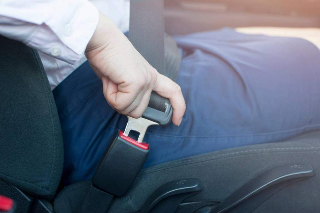 st. louis woman buckling seatbelt