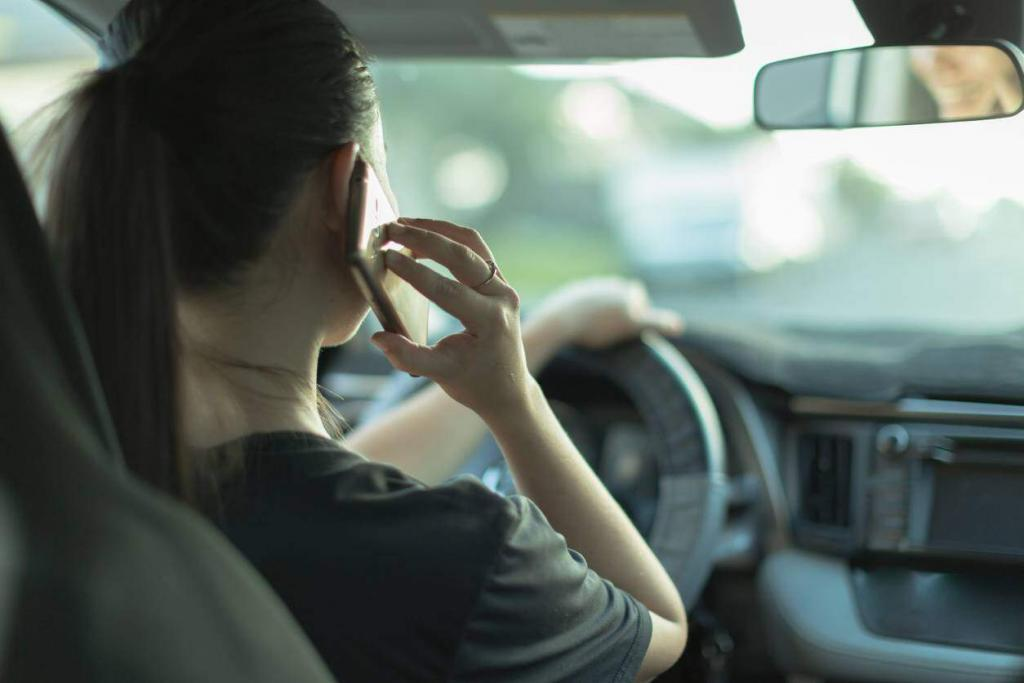 young woman on phone while driving
