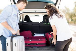 couple packing for holiday travel