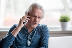 st. louis man on the phone with insurance company