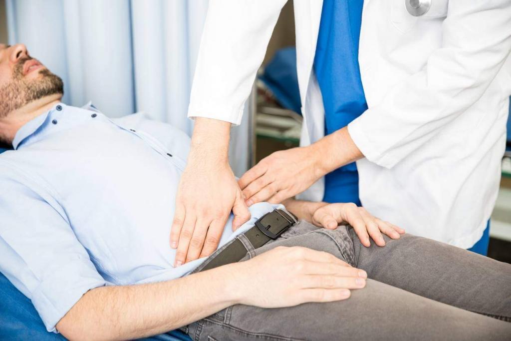 doctor examining abdomen