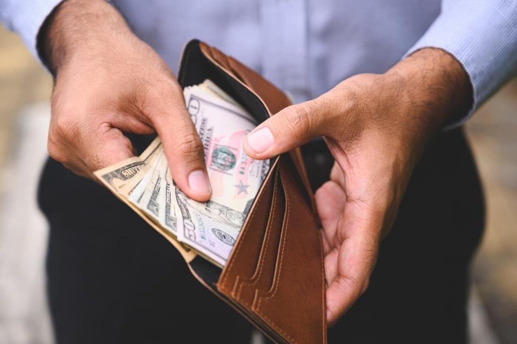 st louis man putting cash in his wallet