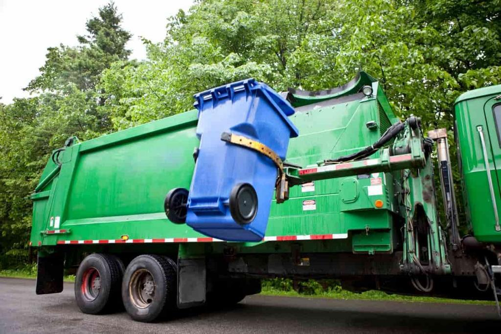 garbage truck collecting trash