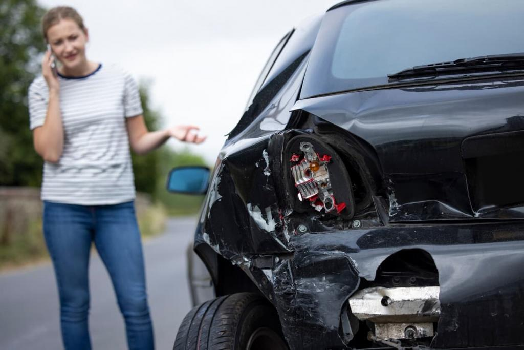 woman on the phone after a miss and run accident