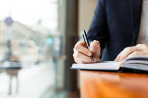 insurance adjuster taking notes