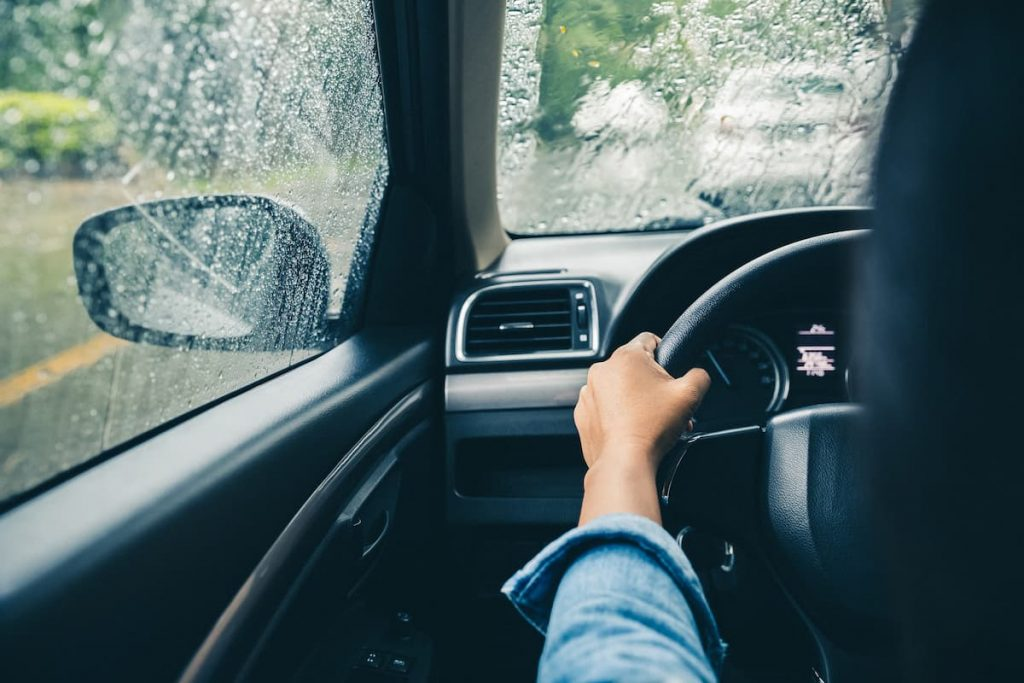 st. louis woman driving in rainy weather