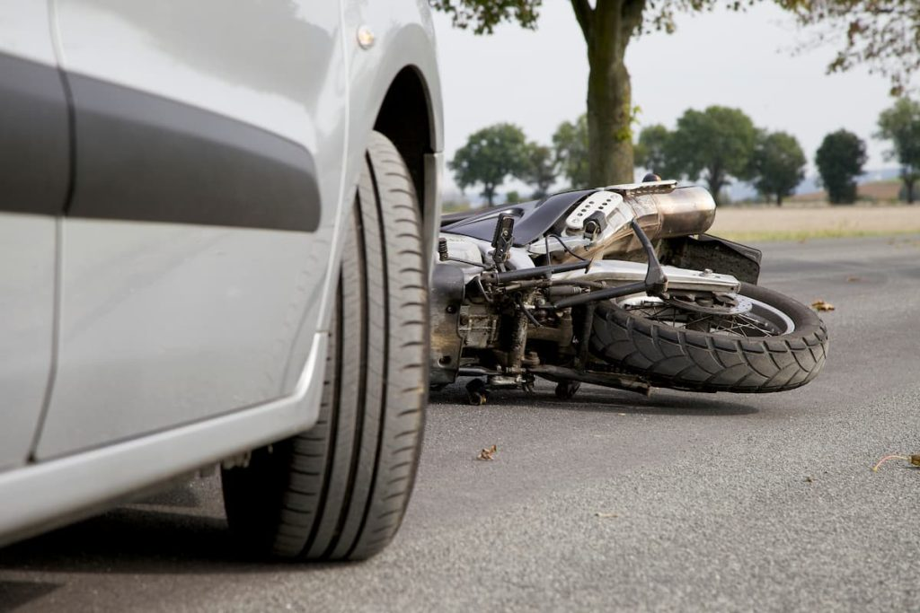 motorycle that has been hit by a car