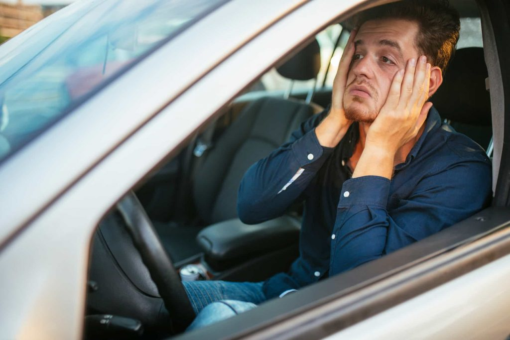 young man stuck in traffic
