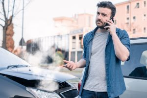 st. louis man stressed on the phone after a car accident